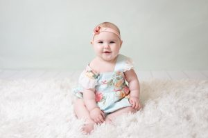 Six month SitHappy studio session on white fur