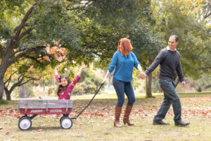 wagon walk in the park tossing leaves