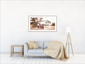 Living room with large wall art family portrait