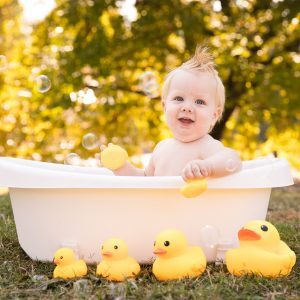 outdoor 1 year bubble bath in the park with rubber duckies
