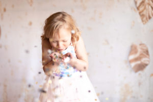 Tossing glitter for fun in the studio